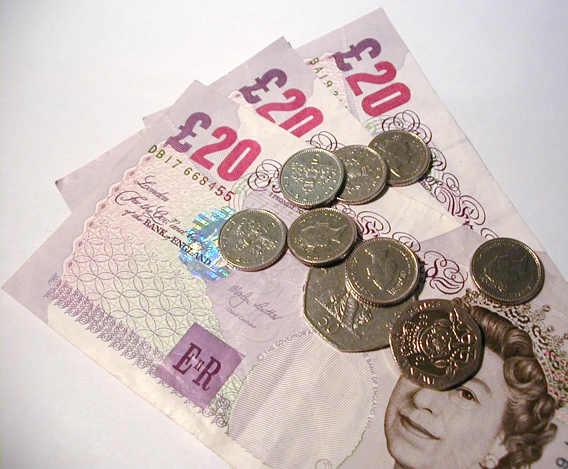 A photograph of money, including £20 notes